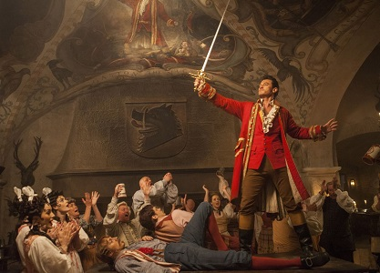 Gaston (Luke Evans) a handsome but arrogant brute, holds court in the village tavern in Disney's BEAUTY AND THE BEAST, directed by Bill Condon, a live-action adaptation of the studio's animated classic and a celebration of one of the most beloved stories ever told.