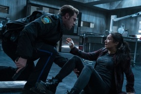 Andrew (Grey Damon) stumbles across Megan (Shay Mitchell) in the cadaver drawer room in Screen Gems' THE POSSESSION OF HANNAH GRACE.